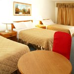  This non-smoking room has 3 double beds for up to 6 persons, complete with 4 pc bath, cable tele