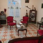 The sitting room where Carlos's Great Aunts paintings are