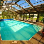 The indoor/outdoor pool building at Sun & Ski Inn and Suites