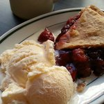 Cherry pie with vanilla ice cream.