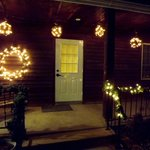 Front door/porch with Christmas decorations