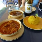 Hinlay pork curry & spicy chicken curry with yellow rice
