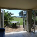 Enjoy the outdoor setting overlooking the beach and ocean