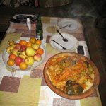 Great local food, in this photo brought and served at our apartment..