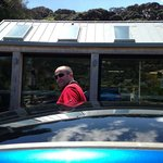 """Front of Piha Cafe (along with my """"hubby"""" and car)"""