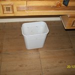 Dirty room and dirtier open bins in teh room