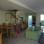 Living and dining area with stairs to upstaris