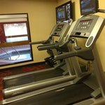 fitness center, two treadmills, elliptical, and bike and small weights.