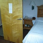 Bathroom door blocks access to bed