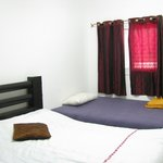 Master bedroom with two beds- duble size and singel bed.