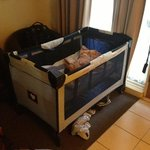  bubba setup in her porta-cot in the room