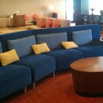 Retro common area did have modern features like huge flat screen TV (in front of couch, not show