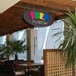"The open veranda of the beach café ""Divan Sea Lounge"" will hide you from midday summer heat. In"