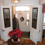 The inside of the front door with its amazing stained glass doors.