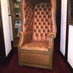 Elegant leather chair in the lobby, typical of the furnishings.
