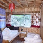Room with a doube and single beds