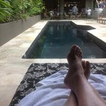 siesta & relaxing on covered double pad pool side