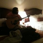 my son playing his guitar