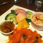 Smoked salmon, poached salmon, prawns, chutney.