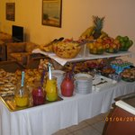  Check out this great h reakfast buffet. Freshly squeezed orange juice, fresh fruit, coissants, .