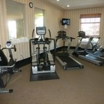 Fitness center with elliptical, treadmill and bike.