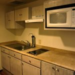 Kitchenette with no cookware or coffee maker