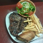 Porterhouse Steak (1 lb.) served with house salad, bread & baked, mashed or FF potatoes