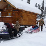 Overnight snow machine and dog sled tours