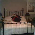 Double bed with feather pillows and duvet