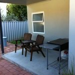 two bedroom spa unit has its own BBQ area and seating. is free standing
