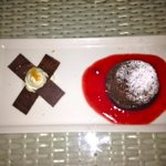  Chocolate fondant with raspberry coulis and chocolate chips