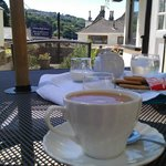 our welcome cup of tea & biscuits on the front patio looking down to the estury