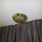 THe light fixture over the window seat.