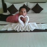 romantic swan towel on bed.