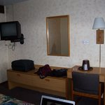 King room - dresser, desk, cable TV, chair in corner