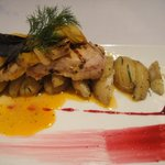 Pork with artichoke hearts and jamaica reduction