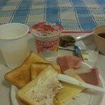 Free breakfast: Toast, ham, cheese, yogurt, fruit. Plenty enough.