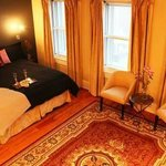 Joyice Ann suite's king-size bed, triple-pane windows & black-out curtains ensure a restful slee