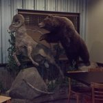 Bear chasing ram decor