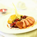 Duck-breast fillet with honeyed plum and grapes, served with strudel filled with vegetables