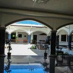  View of the courtyard from the front entrance, breackfast area across the way