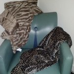 Blankets are mine from home - love the art deco leather chair.