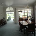  view of breakfast room into living room and side garden