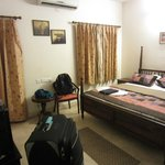 Another view of my bedroom, where you can see the TV and A/C unit.