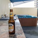  Enjoy a beer by the BBQ on the rooftop area