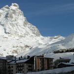  View of Matterhorn and Cretaz Chairlift and pistes above Hotel Breuil next to the Church Bell To