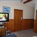 The large tv and door to common area.