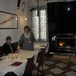 Regina, owner in dining room with fireplace
