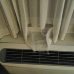 ripped curtains on top of heater