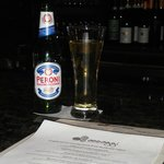 Enjoying an Italian Peroni Beer & Perusing the Restaurant Menu for Appetizers